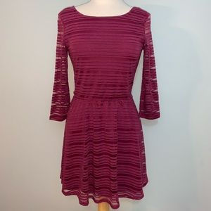 Burgundy scoop back dress with sheer arms